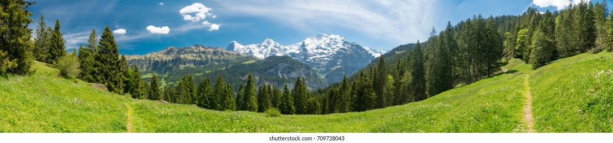Потрясающие виды на горы и пешеходная тропа в швейцарских Альпах в районе Штехельберг Лаутербруннен, Швейцария