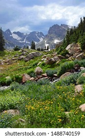 spectacular navajo, arapahoe, and shoshone peaks and a lovely mountain stream as seen in summer  on the hiking trail  up to isabelle lake in the indian peaks wilderness area, near nederland, colorado