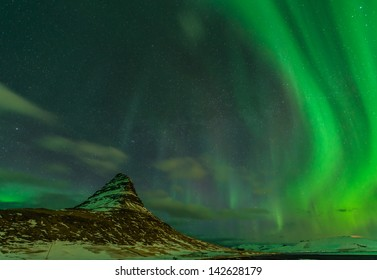 Spectacular northern lights appear over Mount Kirkjufell in Iceland.