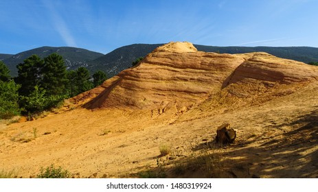 spectacular ochre hills in Colorado Provencal (also called French Colorado) near Rustrel village in Luberon Valley, Provence, France, Europe, popular touristic attraction in former quarry in Provence