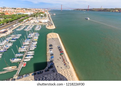 Spectacular panorama of Bridge of 25 April or Ponte 25 de Abril and Tagus or Tejo river from Discoveries Monument or Padrao dos Descobrimentos platform. Belem District, Lisbon, Portugal, Europe.