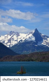 spectacular panorama of fusillade mountain and gunsight ridge from the wild goose island lookout in glacier national park, montana