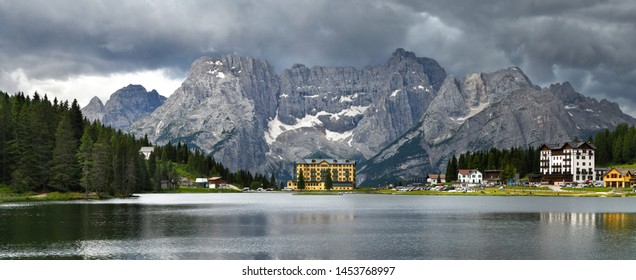 Spectacular Panorama at Misurina lake with Sorapiss Dolomitic Group on background and dramatic cloudy sky. Sexten Dolomites near Cortina d'Ampezzo, Italy. Europe.