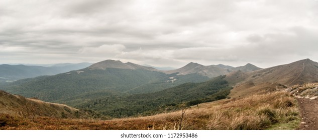 spectacular panorama of wild Bieszczady mountains with many hills covered by mountain meadows and deep forest from Rozsypaniec hill in Poland during cloudy autumn day