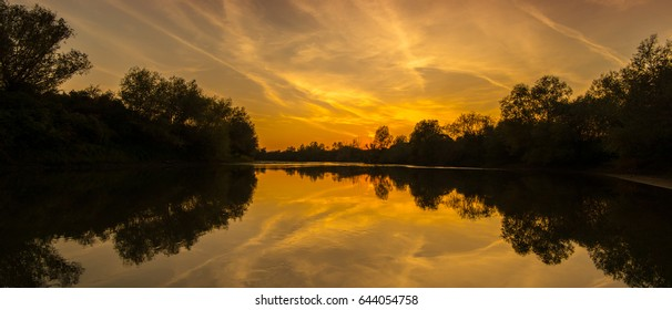 Spectacular panorama of wild river with sunset cloudy sky reflection, in autumn - Shutterstock ID 644054758