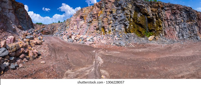 Spectacular panoramic view of quarry open pit mining of granite stone. Production stone and gravel. Groundwater in the quarry.
