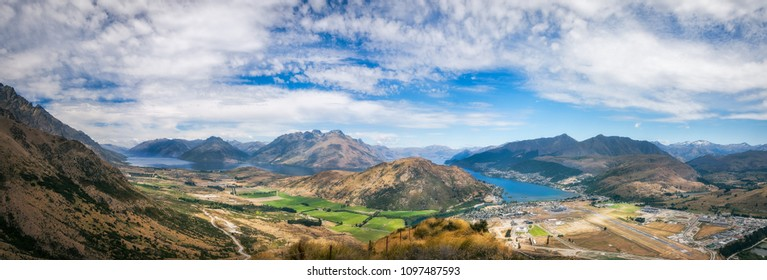 Spectacular Panoramic Views of Lake Wakatipu and the Mountain range surrounding Queenstown city and airport with Queenstown Hill, Ben Lomond and Cecil Peak in the distance -View from The Remarkables.