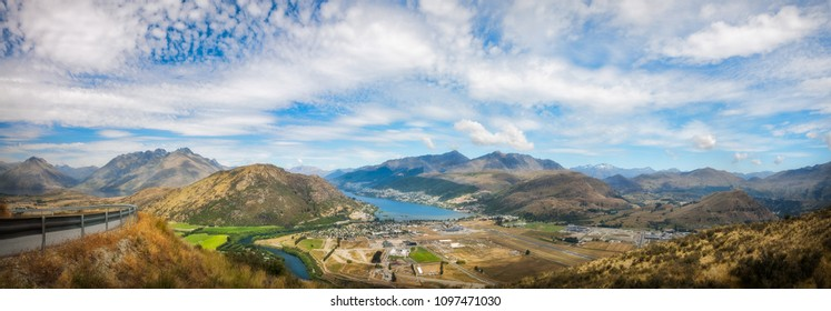Spectacular Panoramic Views of the Mountain range surrounding Queenstown City and Airport with mountain tops such as Ben Lomond, Queenstown Hill, Cecil Peak and Coronet Peak from the scenic road above