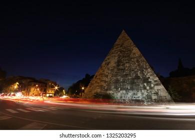 The spectacular Pyramid monument to Caio Cesti Rome, Roma at dusk, Pyramid, piramide, Italy - Shutterstock ID 1325203295