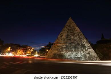 The spectacular Pyramid monument to Caio Cesti Rome, Roma at dusk, Pyramid, piramide, Italy - Shutterstock ID 1325203307