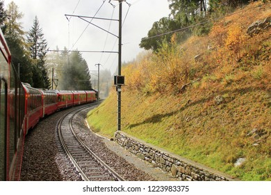 Spectacular rail journey from Chur, Switzerland, to Tirano, Italy, in fall. Famous railway track (UNESCO world heritage) in Switzerland called Bernina Express.