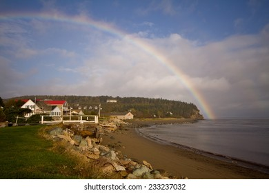 Spectacular rainbow goes into the bay over the village of Alma, New Brunswick, Canada