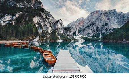 Spectacular romantic place with typical wooden boats on the alpine lake