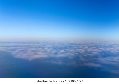 Spectacular sea of clouds On The Plane
