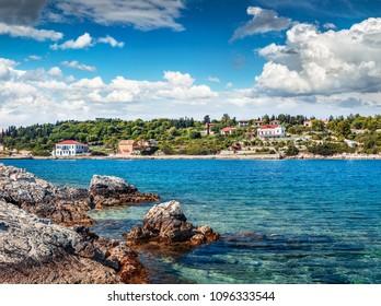 Spectacular spring view of port Fiskardo. Splendid morning seascape of Ionian Sea. Stunning outdoor scene of Kefalonia island, Greece, Europe. Traveling concept background.