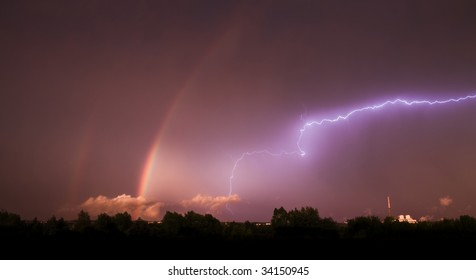 spectacular storm with two rainbows