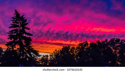 Spectacular sunrise beneath clouds with wild colors