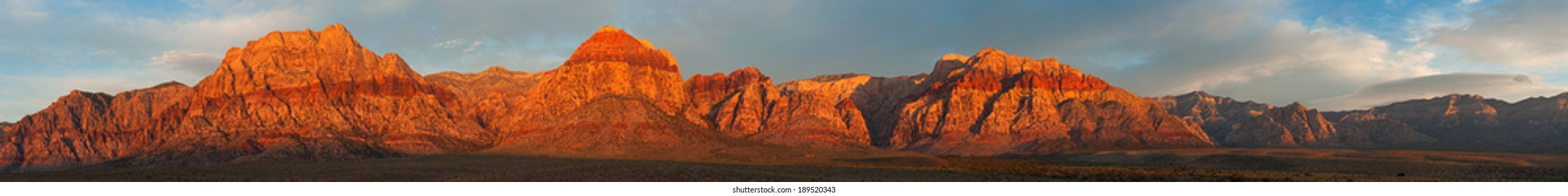 Spectacular sunrise over a mountain range in Red Rock State Park near Las Vegas, Nevada.