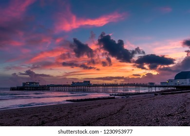 A spectacular sunset display above the shore and sea at Worthing, Sussex, UK