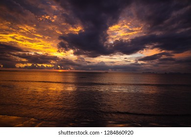 spectacular sunset on tropical island Ko Lanta with storm clouds over the ocean, Andaman Sea, Thailand