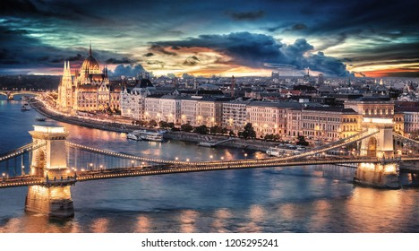 Spectacular sunset over the capital city of Hungary, Budapest. Aerial view with the Danube river, Chain Bridge and the Parliament building.