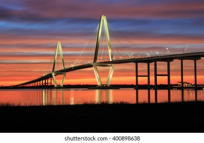 Spectacular sunset over the new cable-stayed Arthur Ravenel bridge across the Cooper River, in Charleston, South Carolina.