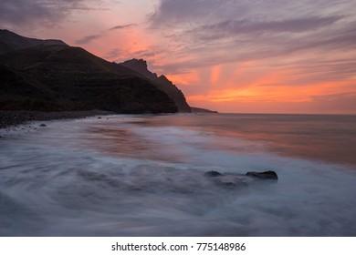 Spectacular sunset over the ocean, Risco Beach, Gran Canaria