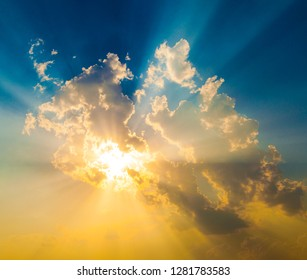 spectacular sunset with sun rays and blue and orange sky