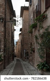 Spectacular traditional italian medieval alley in the historic center of beautiful little town of Spello (Perugia), in Umbria region -  central Italy