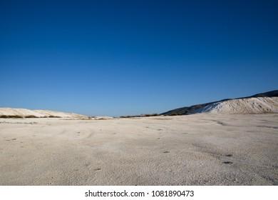 spectacular tranquil landscape with white rocks and limestone at sunny day, salda golu, turkey