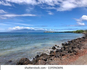 Spectacular Tropical View of Molokai Volcano Mountains, Ocean Coastline, Boats, and Kaanapali Resort Skyline at Lahaina, Maui, Hawaii