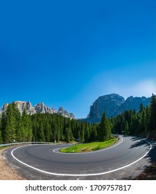 Spectacular u-shape curve panorama in Dolomites with text space, Italy