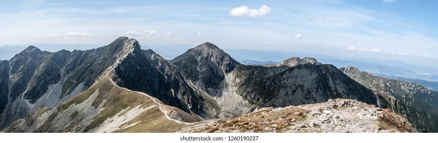 spectacular vew with many peaks and blue sky with clouds from Hruba kopa mountain peak on Rohace mountain group in Zapadne Tatry mountains in Slovakia