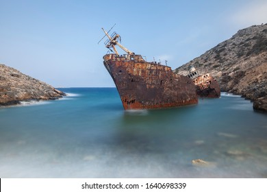 Spectacular view of cargo boat wreck crashed on the shore of cyclade island, Greece.