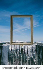 Spectacular view of clear sky and snowy mountain peaks through golden picture frame in Austrian Alps. View from Five Fingers, Obertraun
