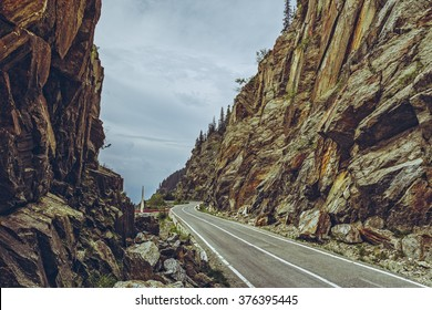 Spectacular view of the famous Transfagarasan road meandering through high rocky steep gorges at an altitude of 2,000 metres in Fagaras mountains, Romania.