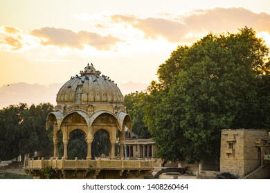 Spectacular view of the Gadi Sagar Lake (Gadisar) with an ancient temple during sunset. Gadi Sagar Lake is one the most important attractions in Jaisalmer, Rajasthan, India.
