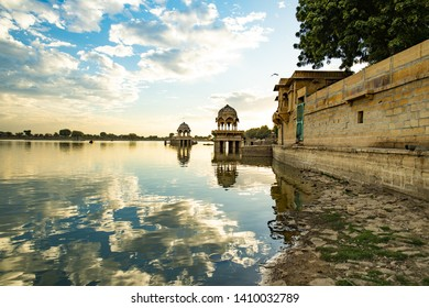 Spectacular view of the Gadi Sagar Lake (Gadisar) with ancient temples during sunset. Gadi Sagar Lake is one the most important attractions in Jaisalmer, Rajasthan, India.