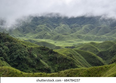 Spectacular view of green hills on a cloudy day in Dzukou Valley, Nagaland