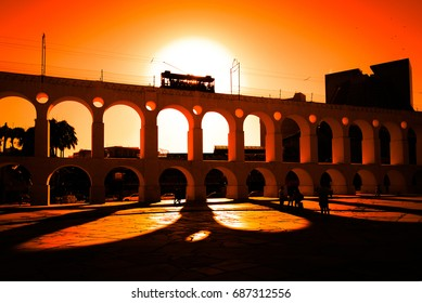 Spectacular View of Iconic Santa Teresa Tram Driving Along the Carioca Aqueduct by Sunset in Rio de Janeiro City Downtown, Brazil