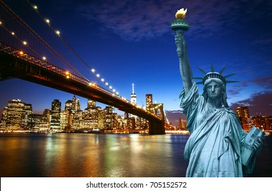 Spectacular view of Manhattan by night with Liberty Statue