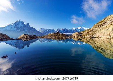 Spectacular View of Mont Blanc and Aiguille Verte Reflections in Lac Blanc, Graian Alps, France.
