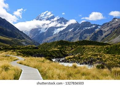 spectacular view of mount cook and the hooker river from along the boardwalk on  the hooker valley track in summer, near mount cook village, on the south island of new zealand