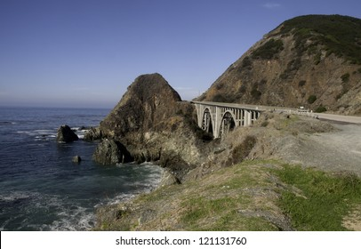 A spectacular view of mountain and ocean and bridge along California's Highway 1.