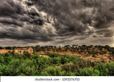 Spectacular view on the hill and greenery with dark, dramatic, stormy clouds in Segovia, Spain.