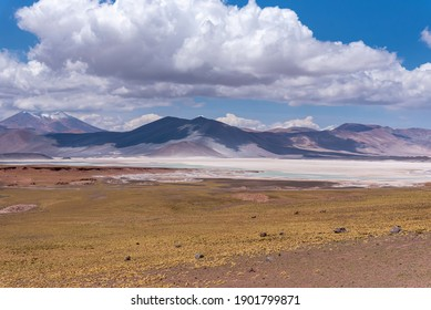 Spectacular view of rocky terrain with hills and salty ground in Atacama Desert in Chile
