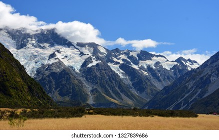 spectacular view of rugged  mountain peaks on a sunny day in summer  near mount cook village in summer, on the south island of new zealand