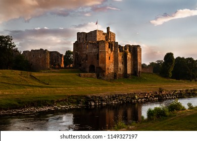 Spectacular view of the ruins of Brougham Castle and stream at sunset in Cumbria, England UK.