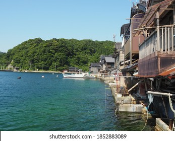 Spectacular view of Sea of Japan coast olf fishing village of Ine in Kyoto prefecture in Japan with old fishing houses, blue sky and turquoise waters of a bay
