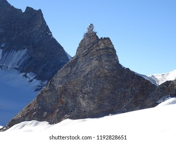 Spectacular view of Sphinx Observatory on Jungfraujoch in Swiss Alps perched on a rocky spur on a pristine Summer day